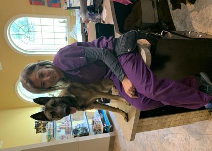 Dog and vet assistant